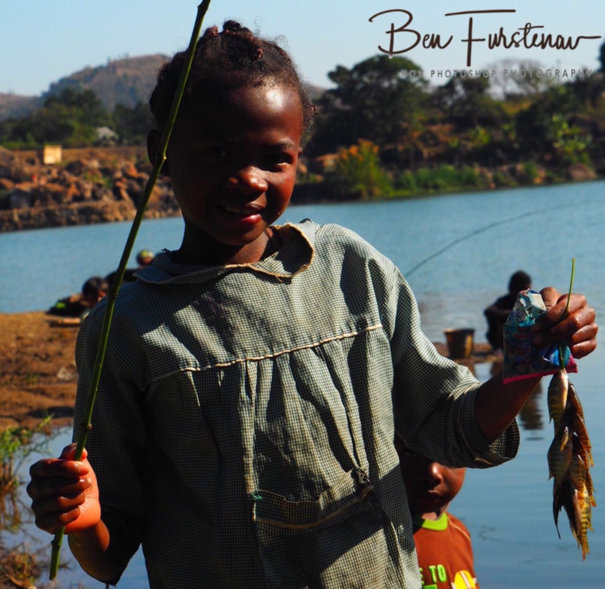 Young girl with her fishing catch