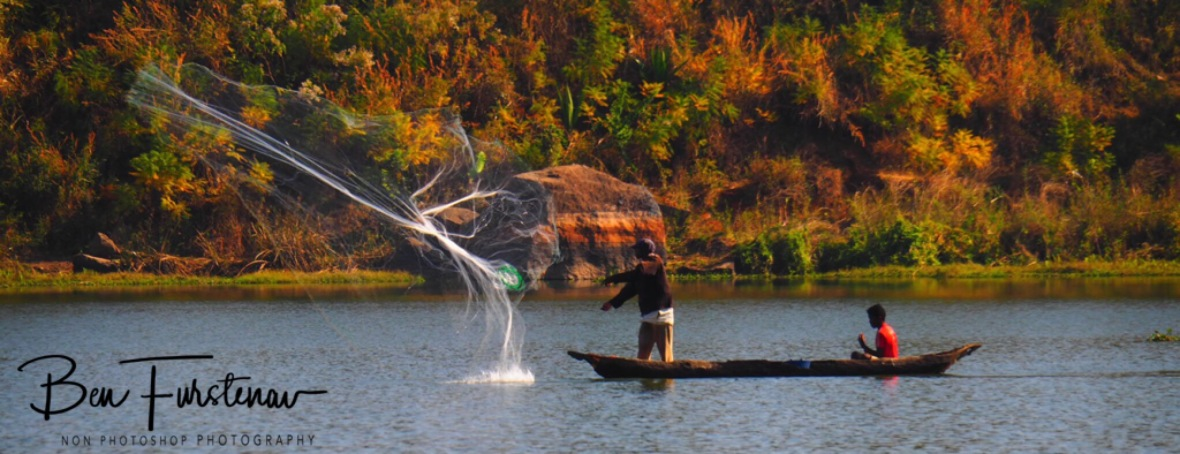 Net casting from a pirogue