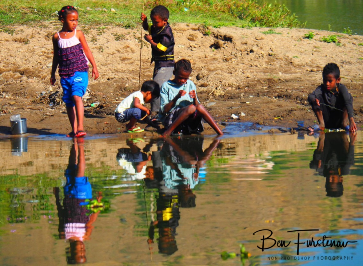 Reflections of children fishing