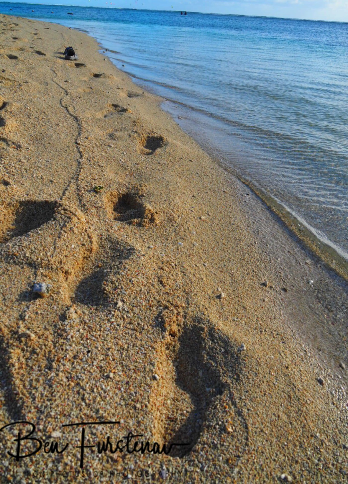 Footprints on the beach, West Coast, Mauritius