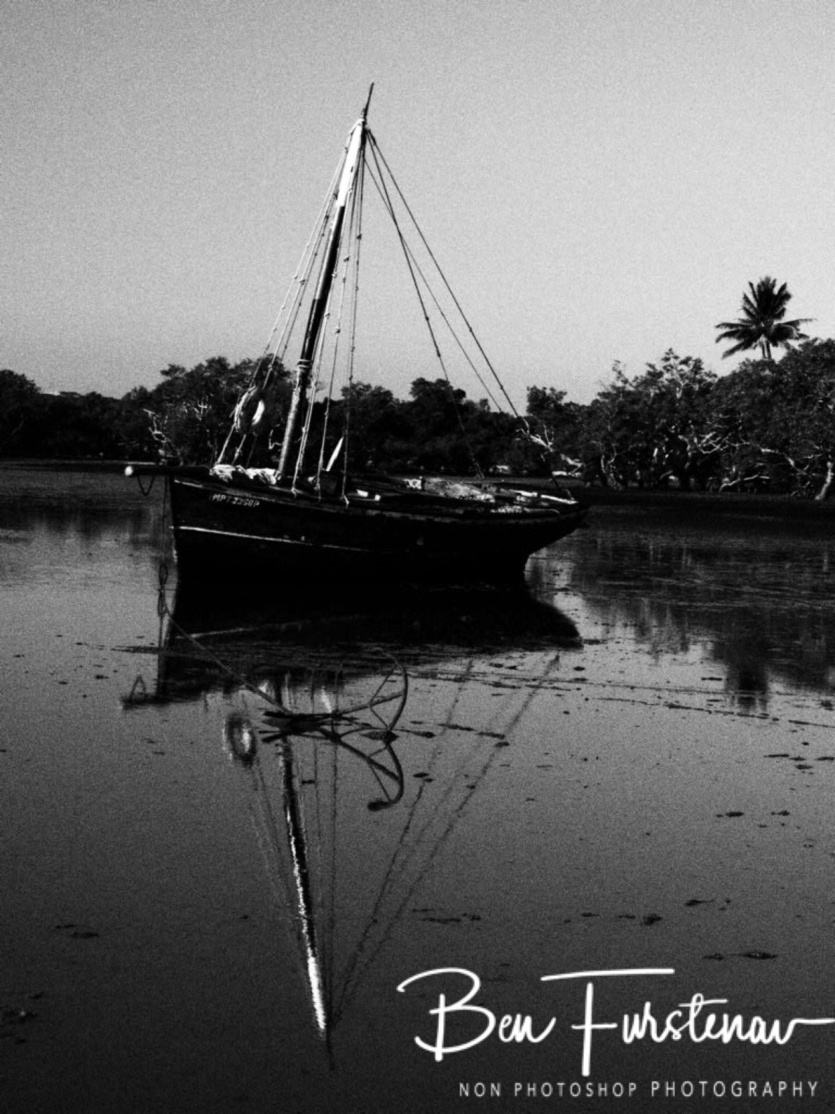 Black and white dhow in very low waters, Santa Maria, Machangulo Peninsula