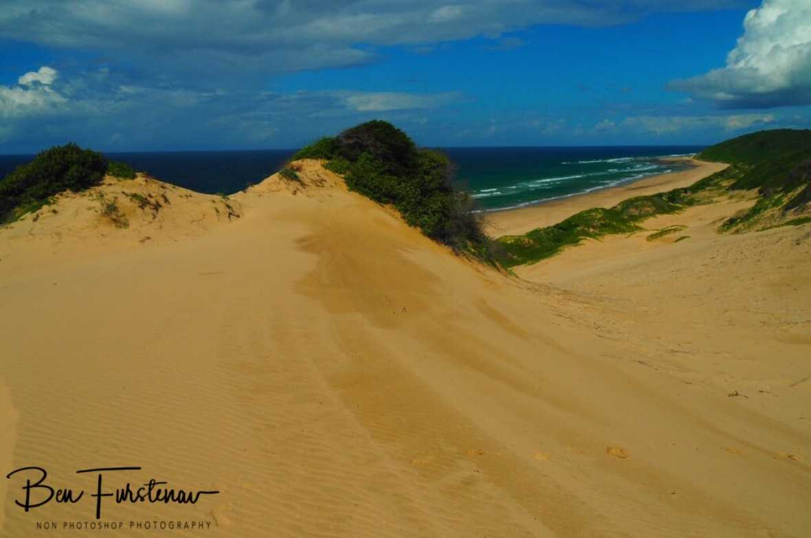 Towering red sand dunes, Machangulo Peninsula