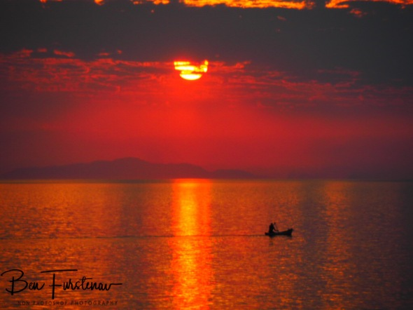 Banana boat fisherman over endless seas at Otter Point, Cape MaClear, Lake Malawi, Malawi