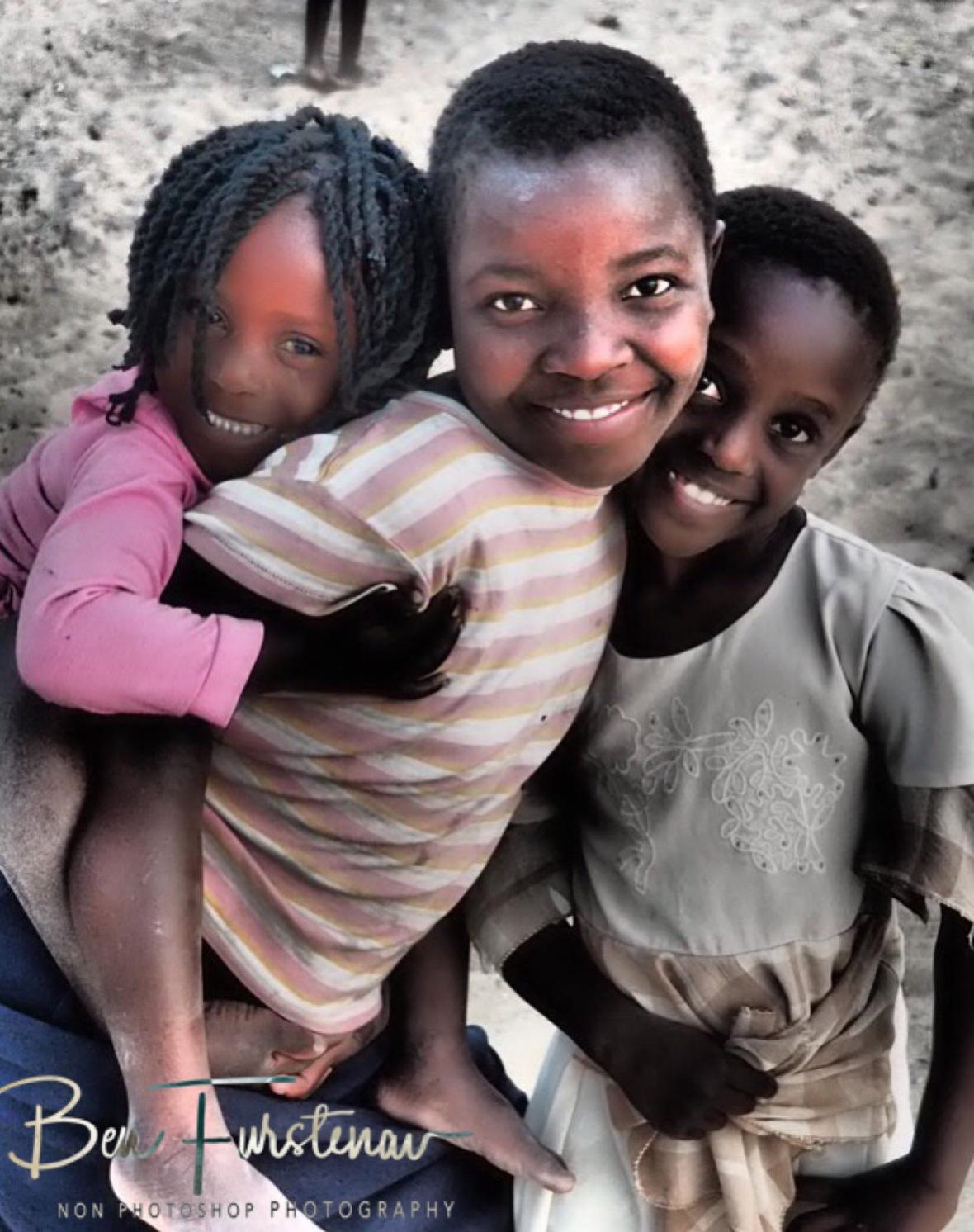 Cute girls posing in Chembe, Cape Maclear, Lake Malawi, Malawi