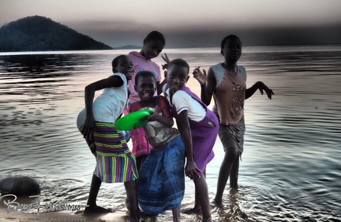 Cheeky girl posing in Chembe, Cape Maclear, Lake Malawi, Malawi