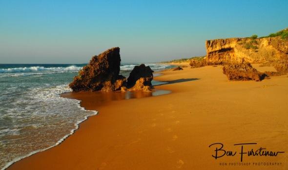 Early morning walk along a remote beach, Barra beach, Inhambane, Mozambique
