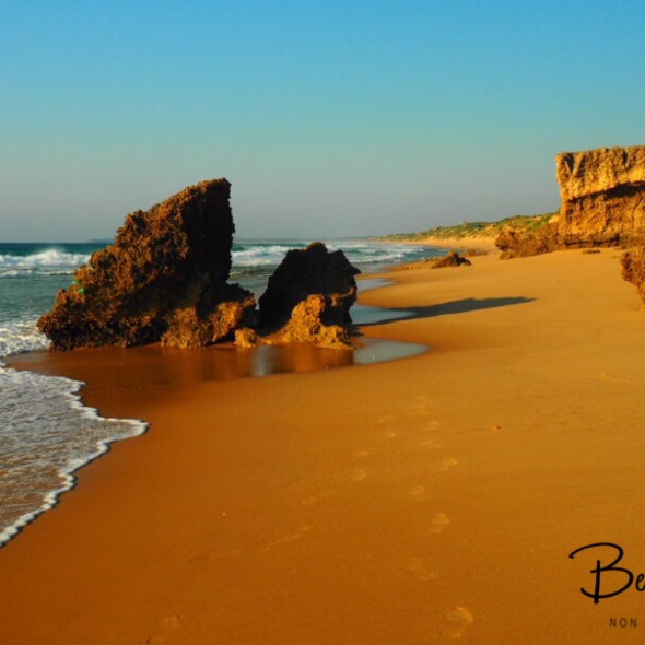 Early morning walk along a remote beach, Barra beach, Inhambane, Mozambique