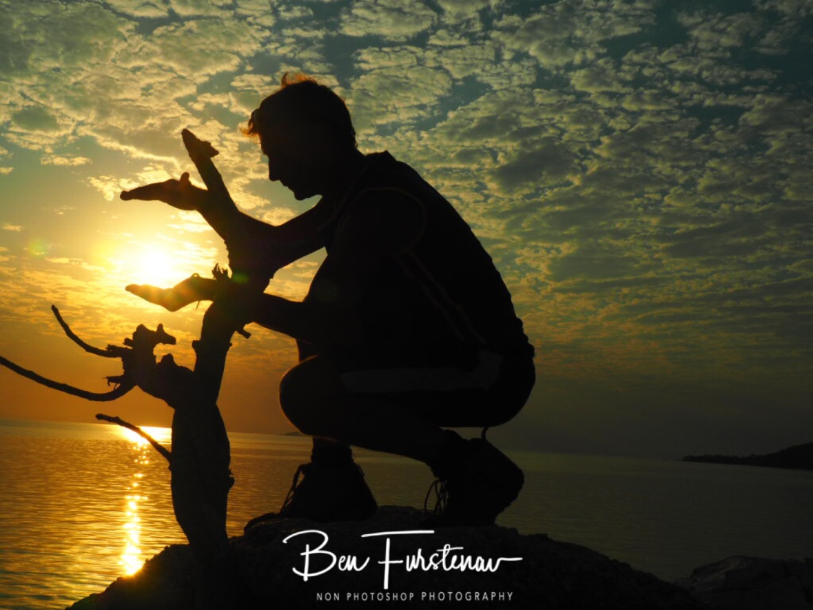 Holding the sun at Otter Point, Cape MaClear, Lake Malawi, Malawi