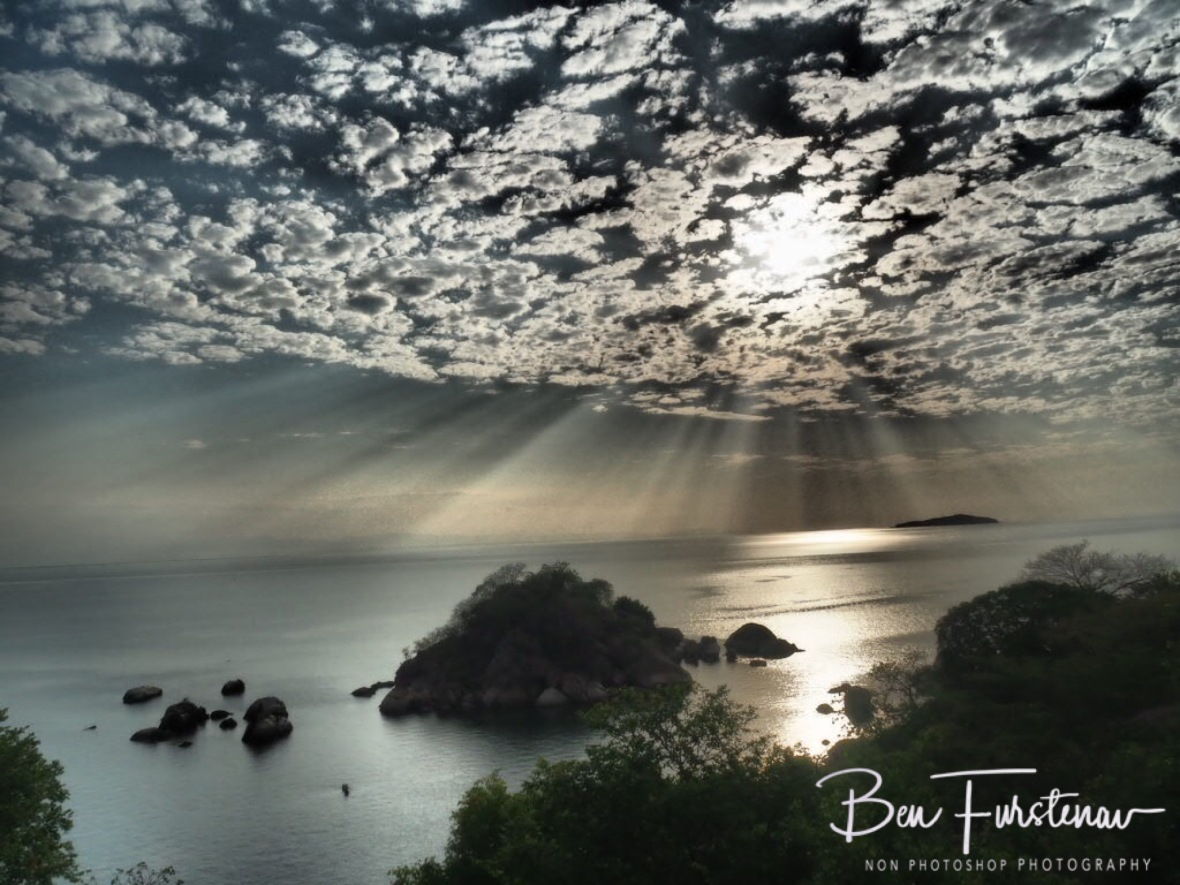 Spectacular display off sun and clouds over Lake Malawi, Otter Point, Malawi