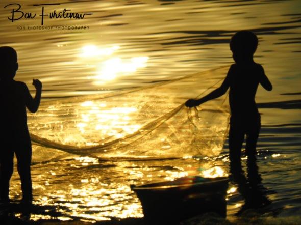 Kids net fishing in Chembe, Cape Maclear, Lake Malawi, Malawi