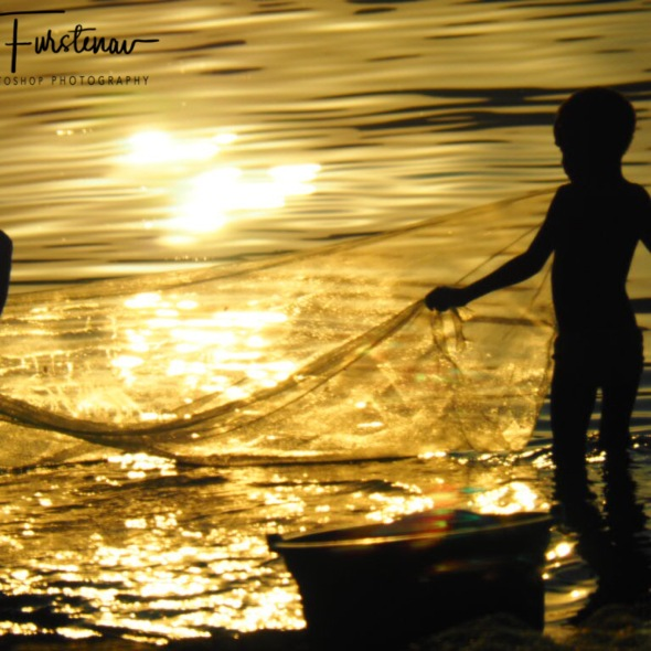 Kids net fishing in Chembe, Cape Maclear, Lake Malawi, Malawi