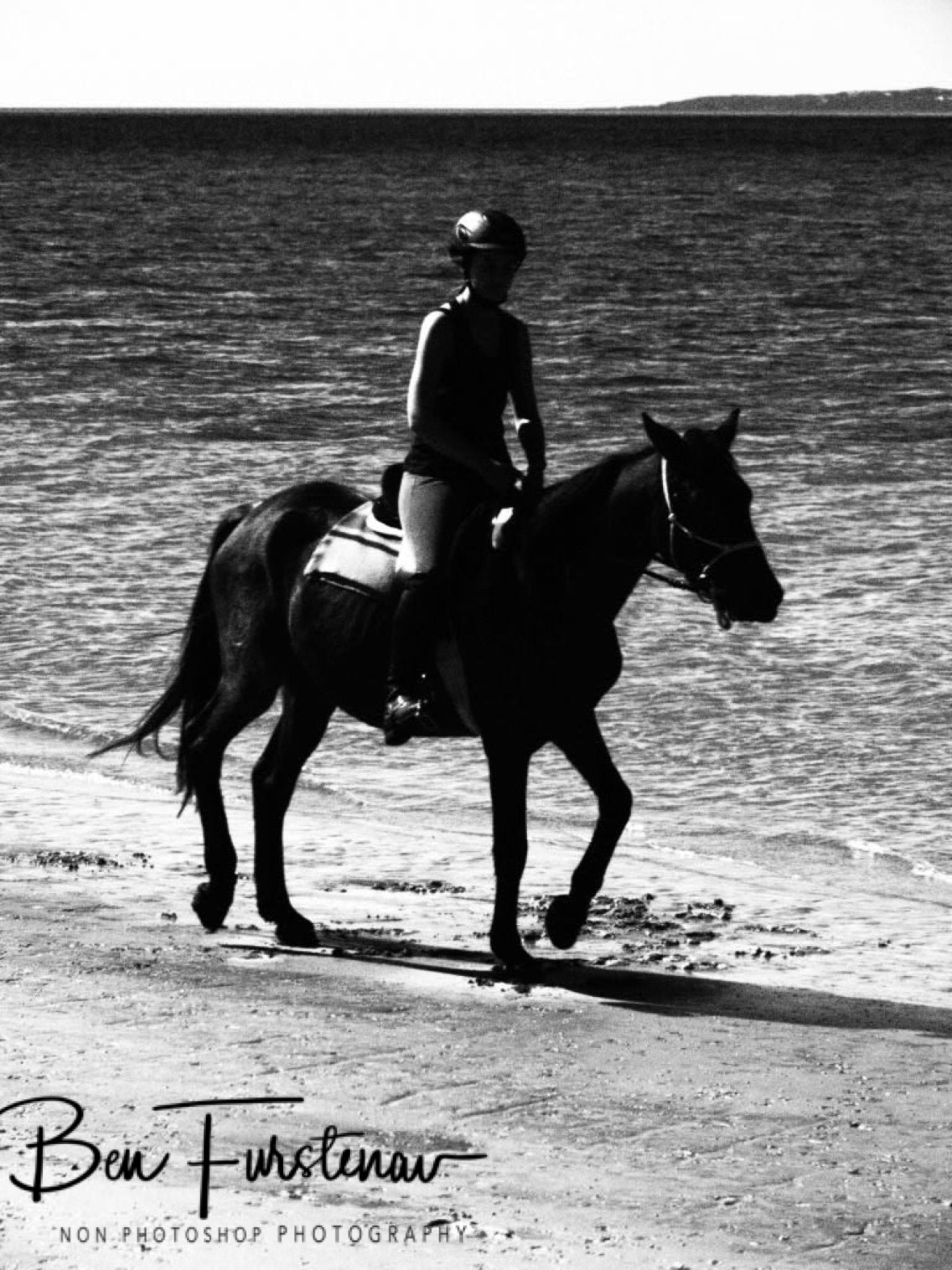 Black and white riding on the beach, Vilankulo, Mozambique