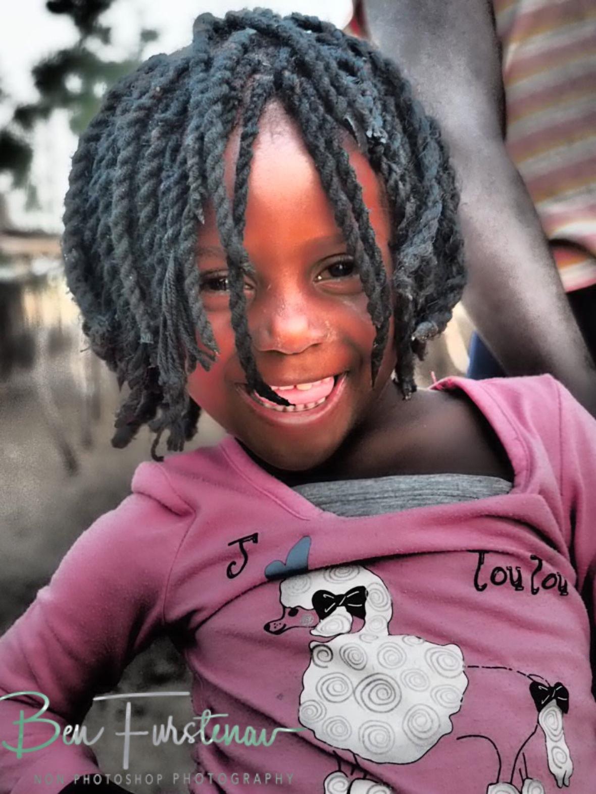 Cute locks and smiles in Chembe, Cape Maclear, Lake Malawi, Malawi