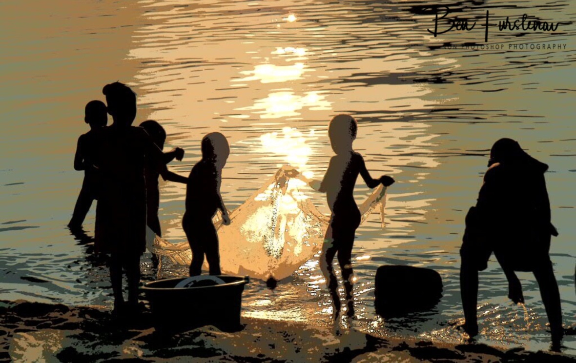 Kids in paintings at sunset in Chembe, Cape Maclear, Lake Malawi, Malawi