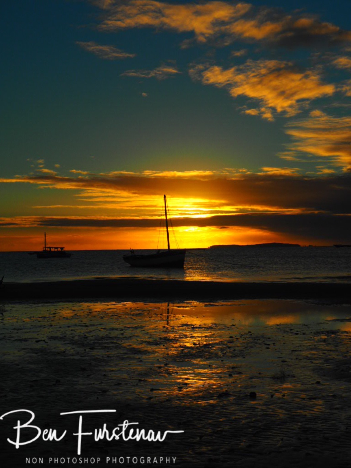 Dhow sunrise in tidal waters, Vilankulo, Mozambique