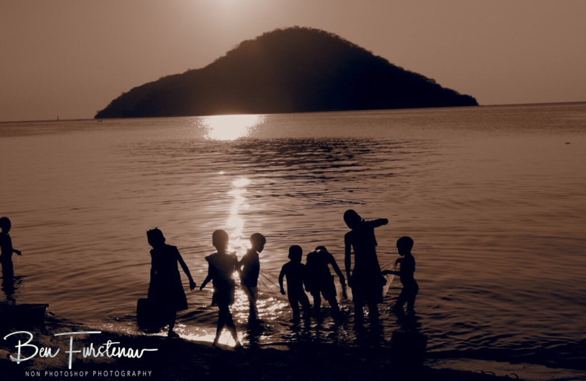 Typical sunset spectacle on Lake Malawi's shores, Chembe, Cape MaClear, Malawi