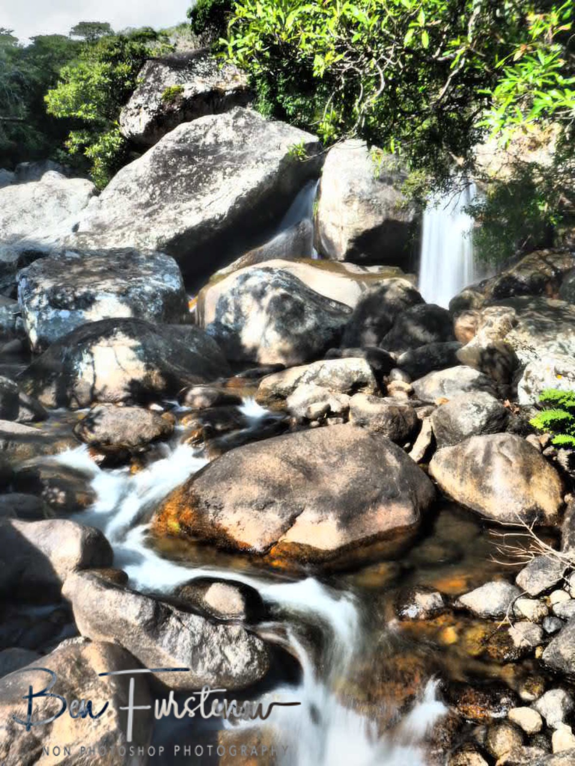 Scrambling over rocks and boulders, Mulanje Mountains, Malawi