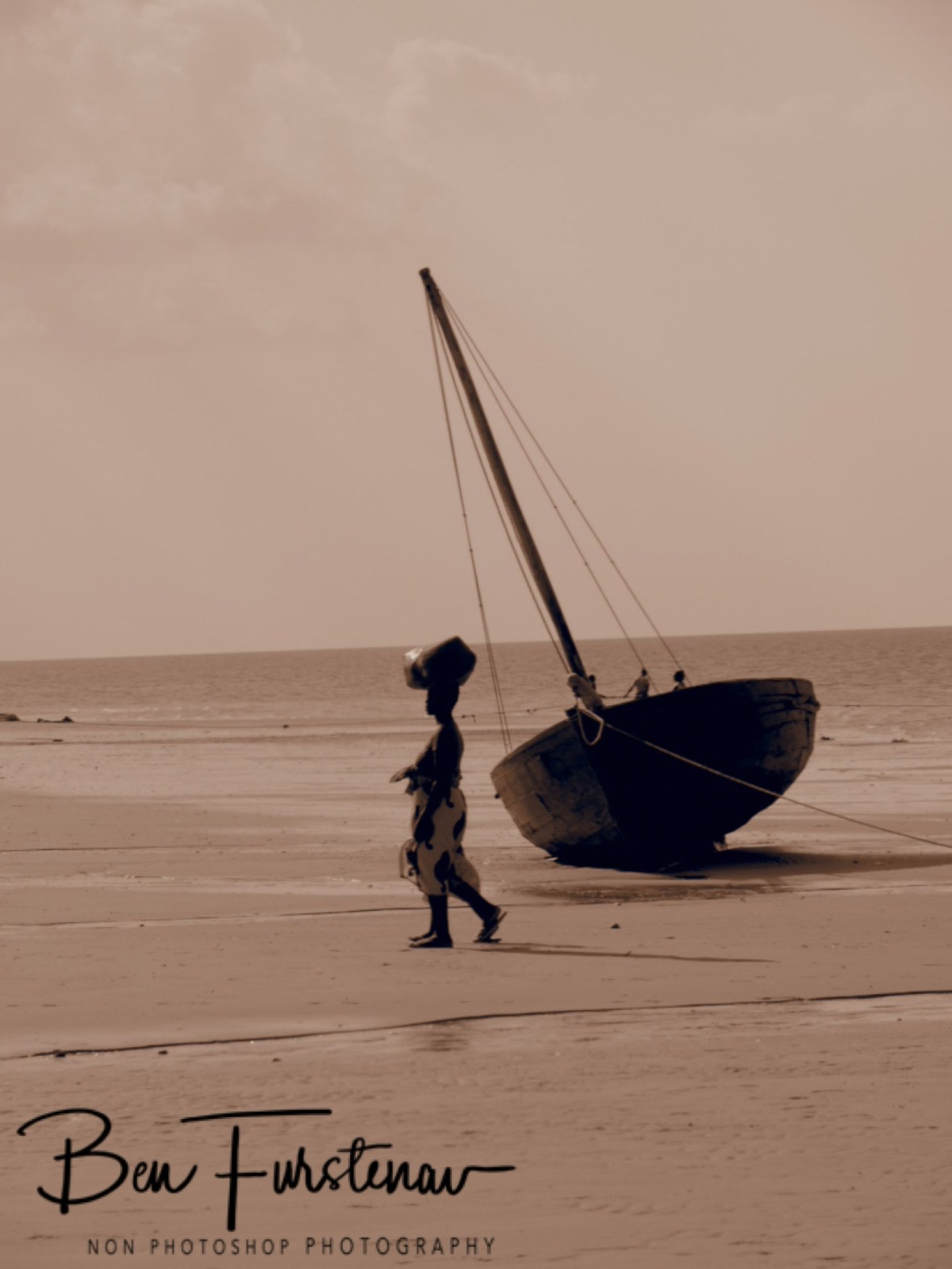 Woman and dhow in sepia, Vilankulo, Mozambique