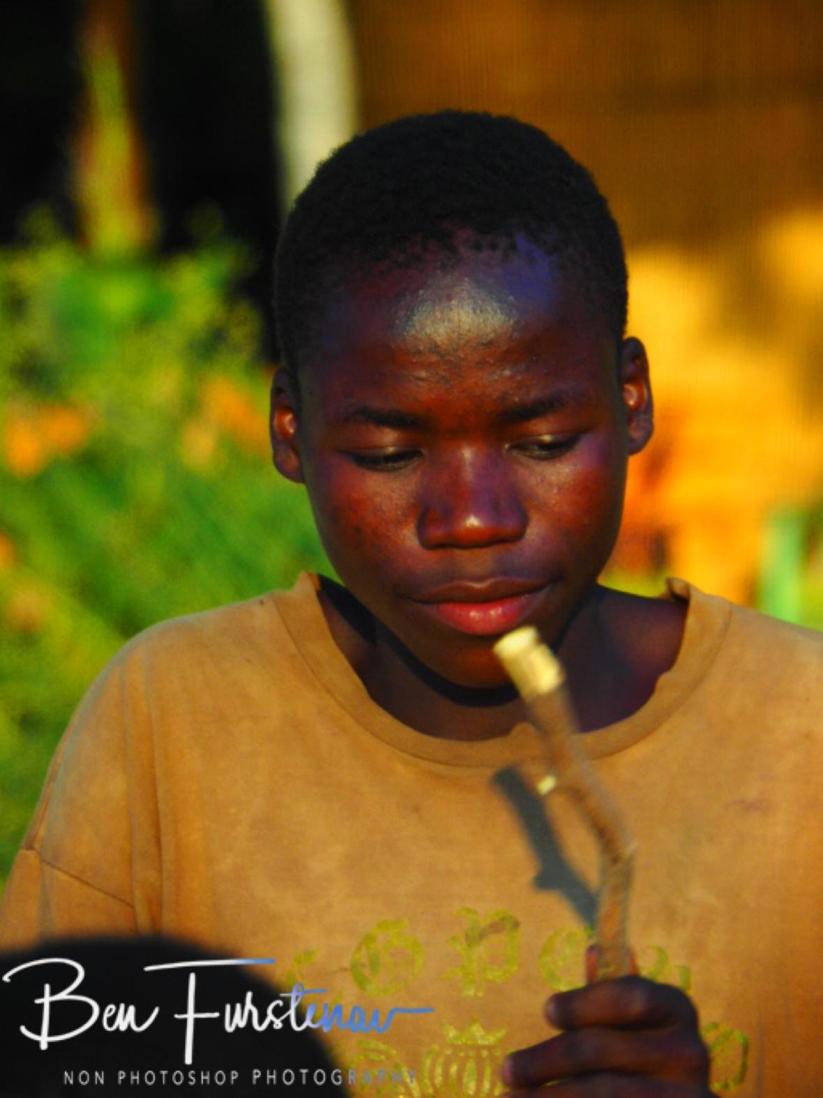 Peace Boys Band drummer in Chembe, Cape Maclear, Lake Malawi, Malawi