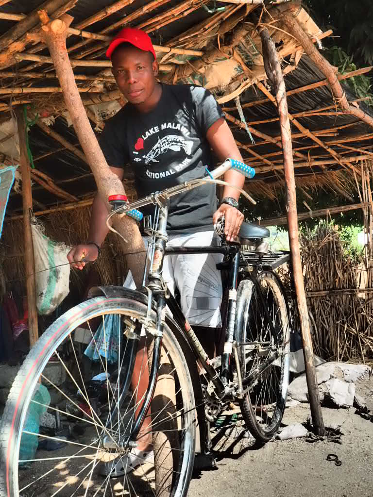 Bike repairs in Chembe, Cape Maclear, Lake Malawi, Malawi