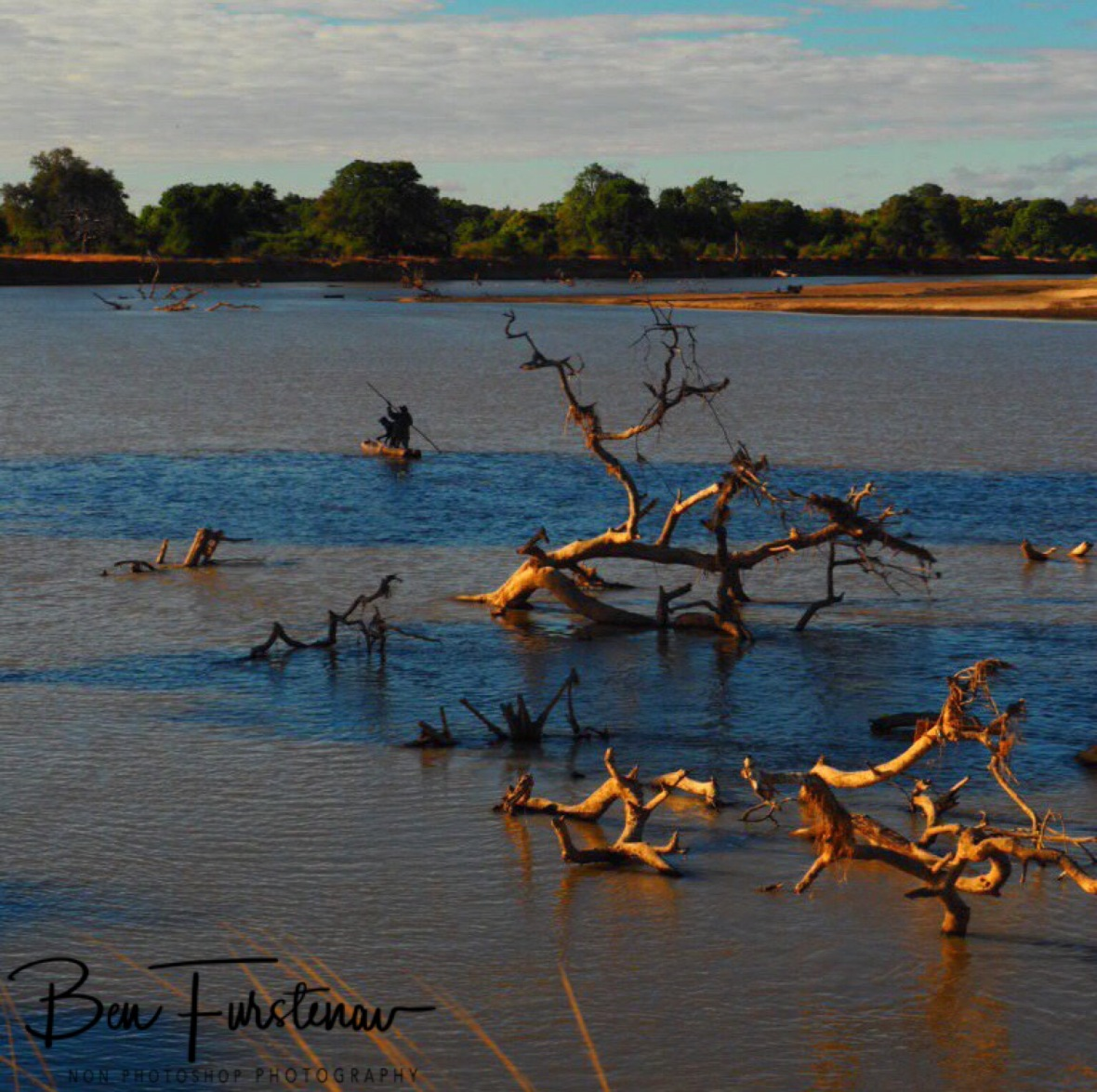 Fishermen dodging tree stumps and hippos, South Luangwa National Park, Zambia