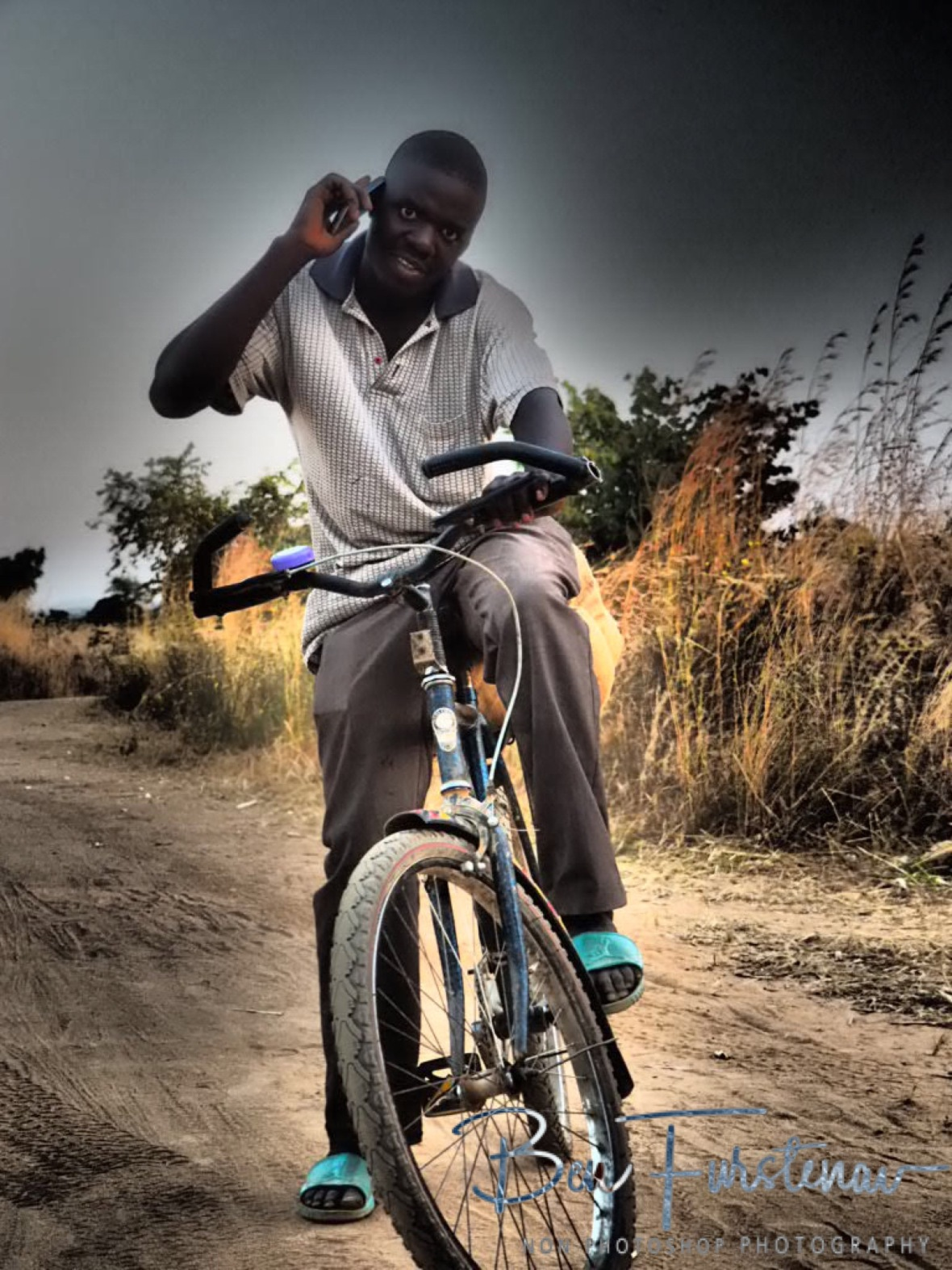 Looking cool on the bike, Northern Region, Malawi
