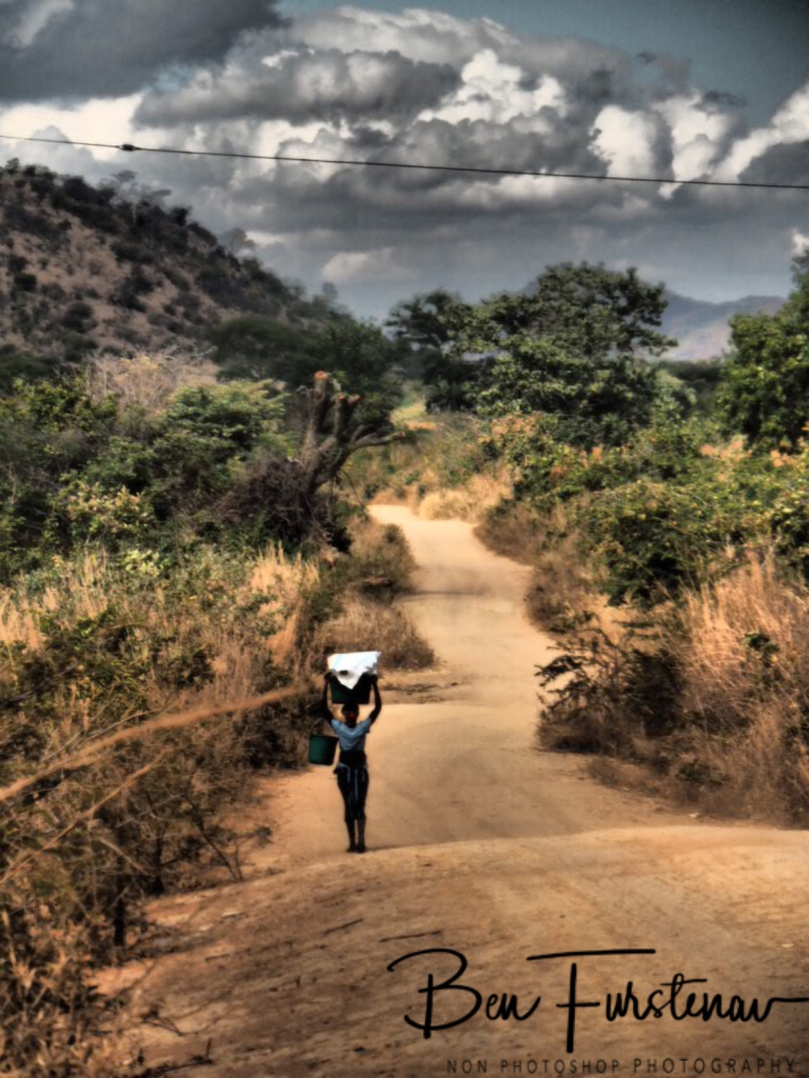 Walking miles for water, Northern Region, Malawi