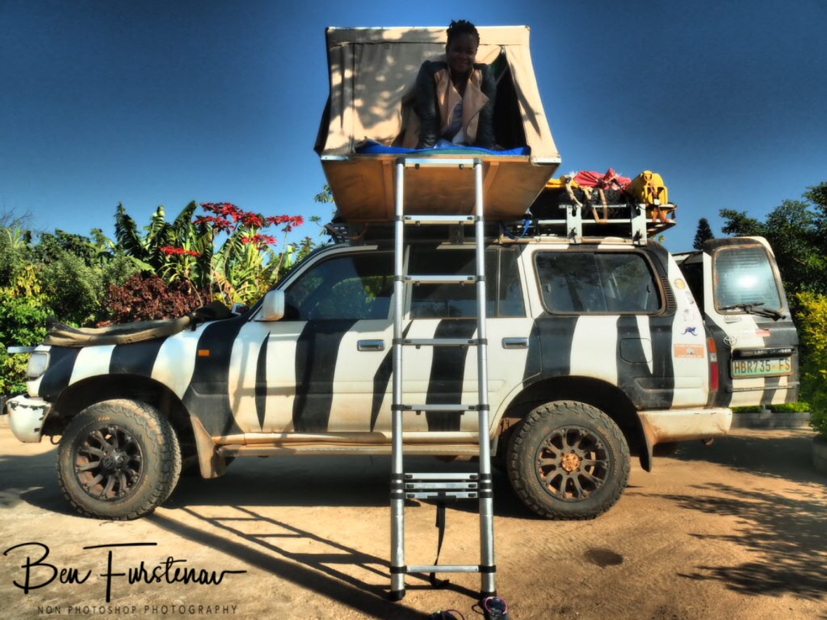 Manuela checking out Zimba's rooftop tent, Lilongwe, Malawi