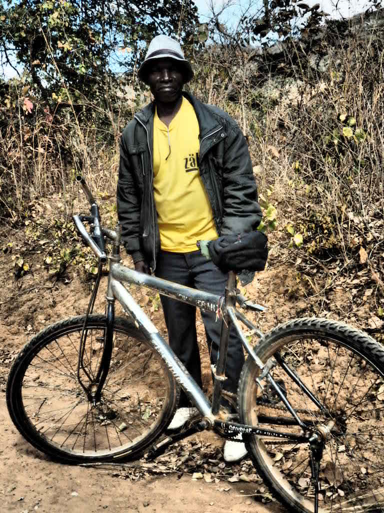 Showing off his modern mountain bike in Northern Region, Malawi
