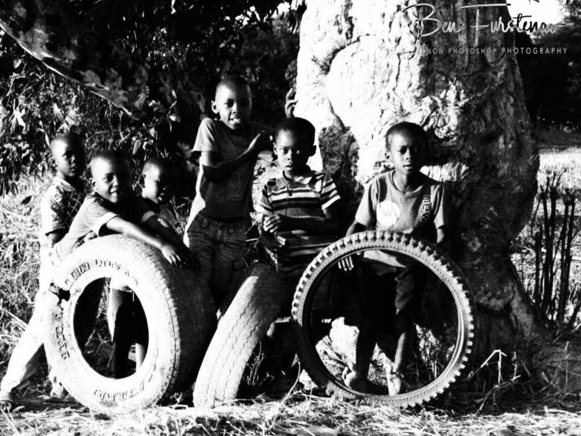 Kids playing with tyres in a remote village in the Northern Region, Malawi