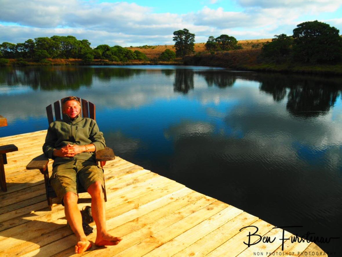 Enjoying a few sun rays with dirty, dusty feet, Chelinde lodge, Nyika National Park, Malawi