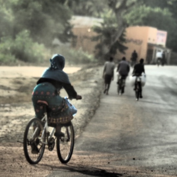 Female mountain bike rider at Salima Region, Malawi