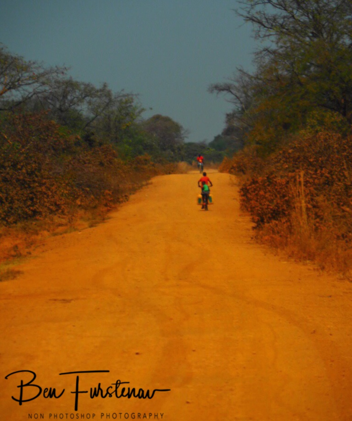 No matter where you are in Africa, always expect a bike to pass you, Blue Lagoon National Park, Zambia