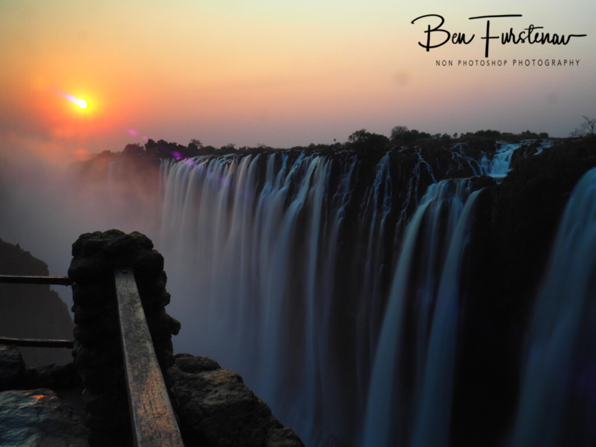 A much needed fence prevents accidents in to the Victoria Falls, Zambia
