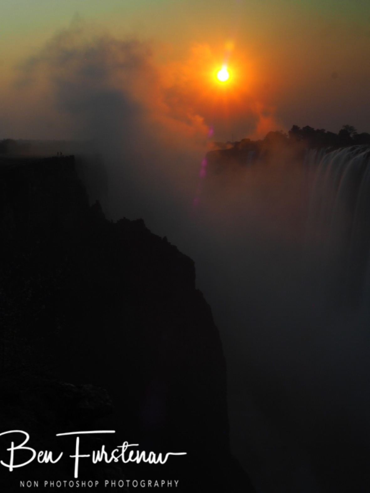 Steaming mist rising up the sun, Victoria Falls, Zambia