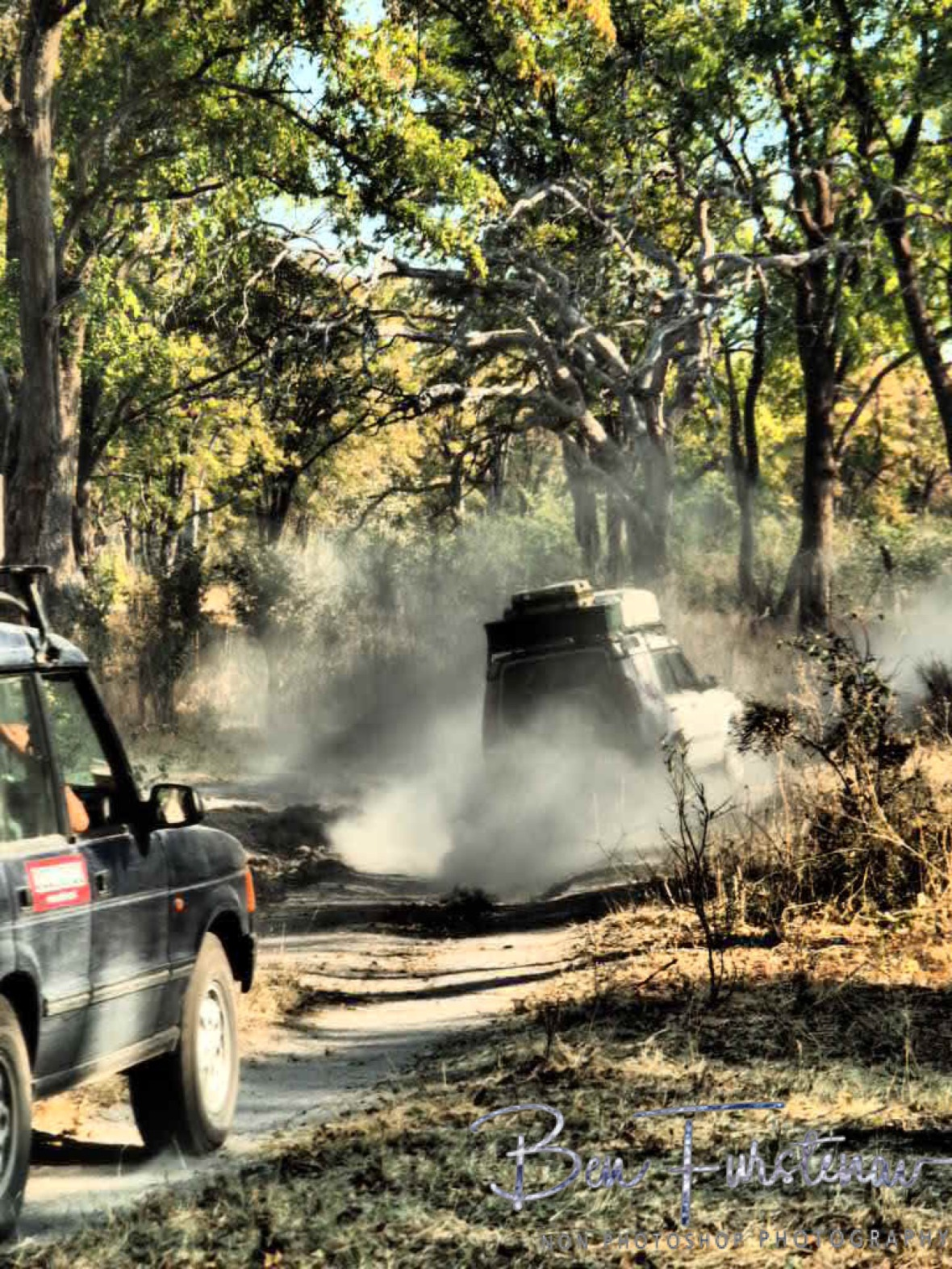 Driving dust tracks, Okavango Delta, Chobe National Park, Botswana