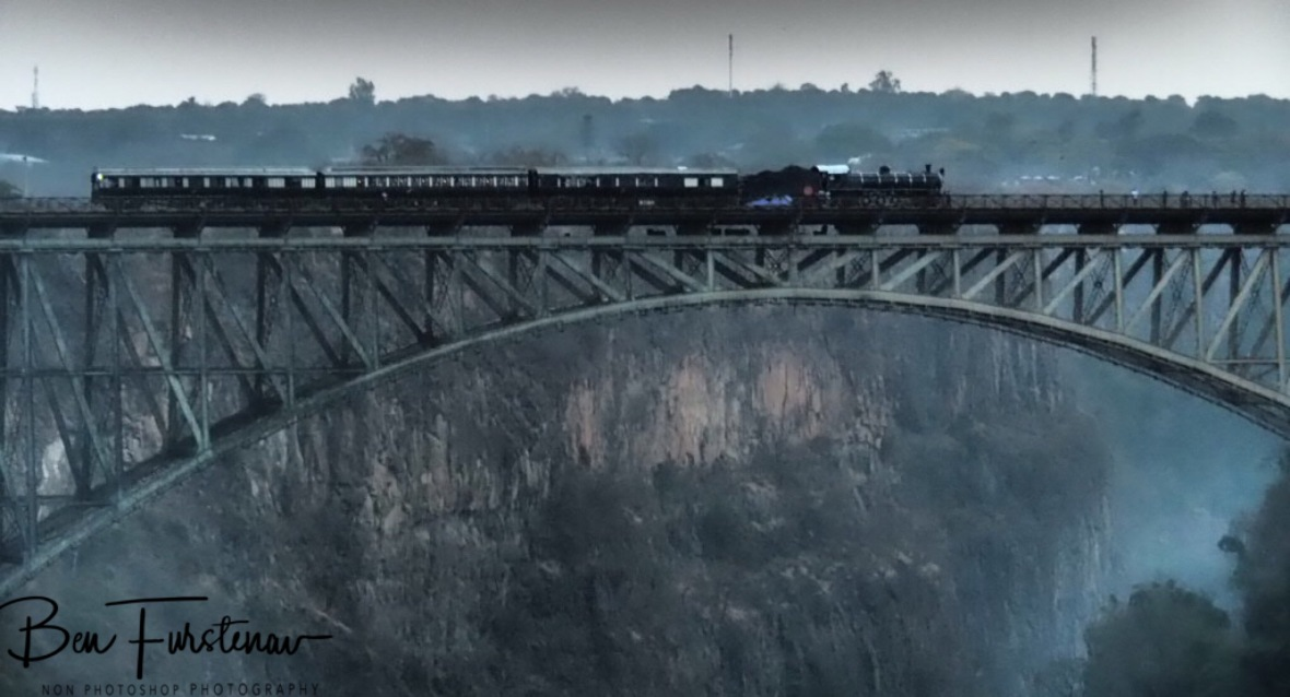Steam train over the Victoria Falls, Zambia