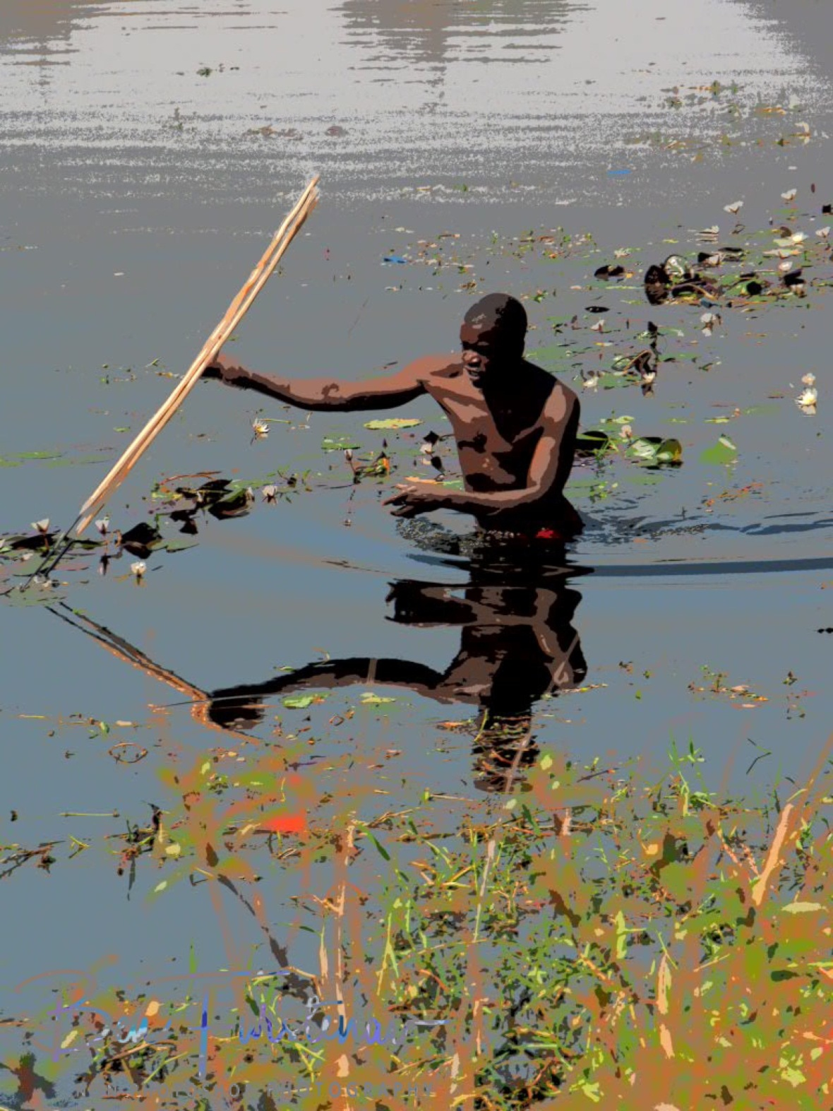 Spearing fish in Liuwa Plains National Park, Zambia