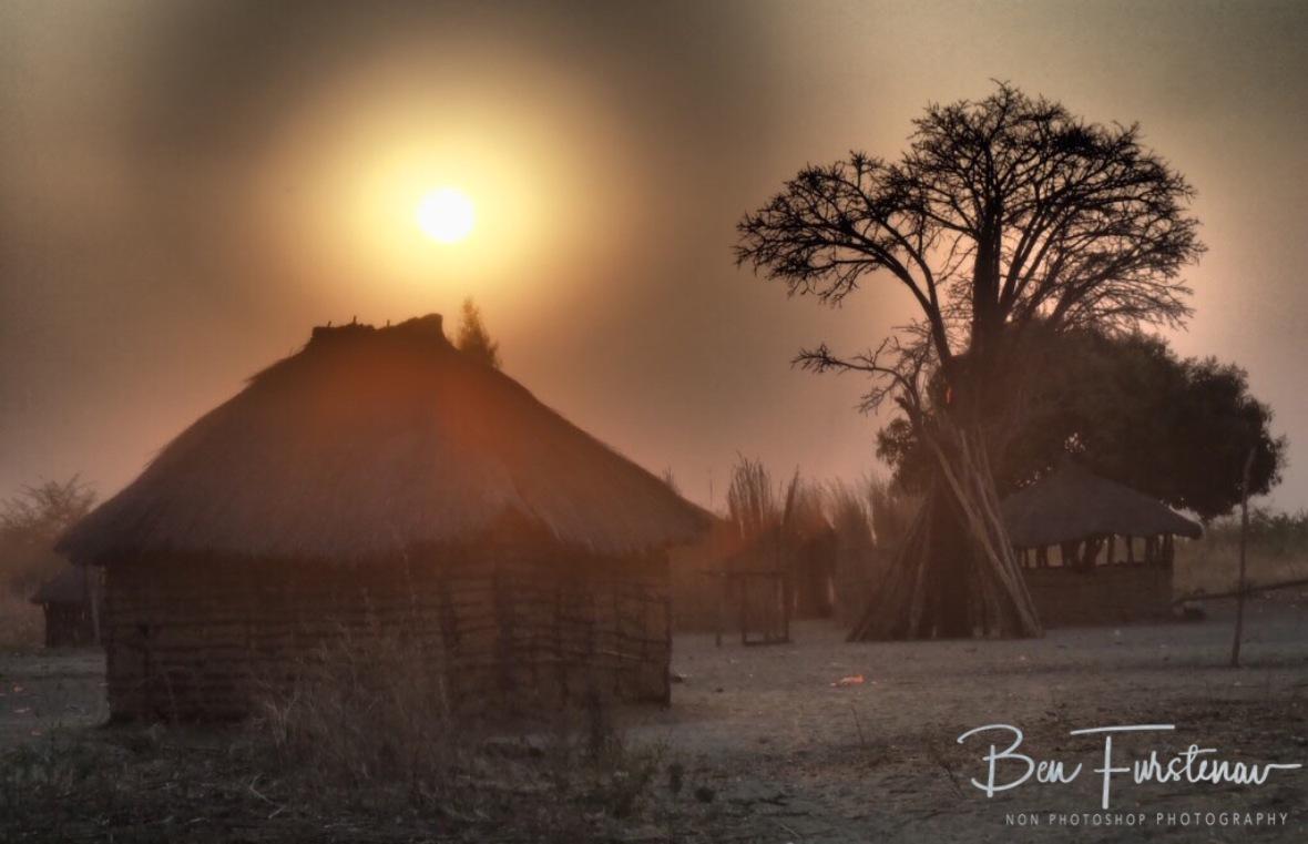 Low setting sun over a community near Lukulu, Zambia