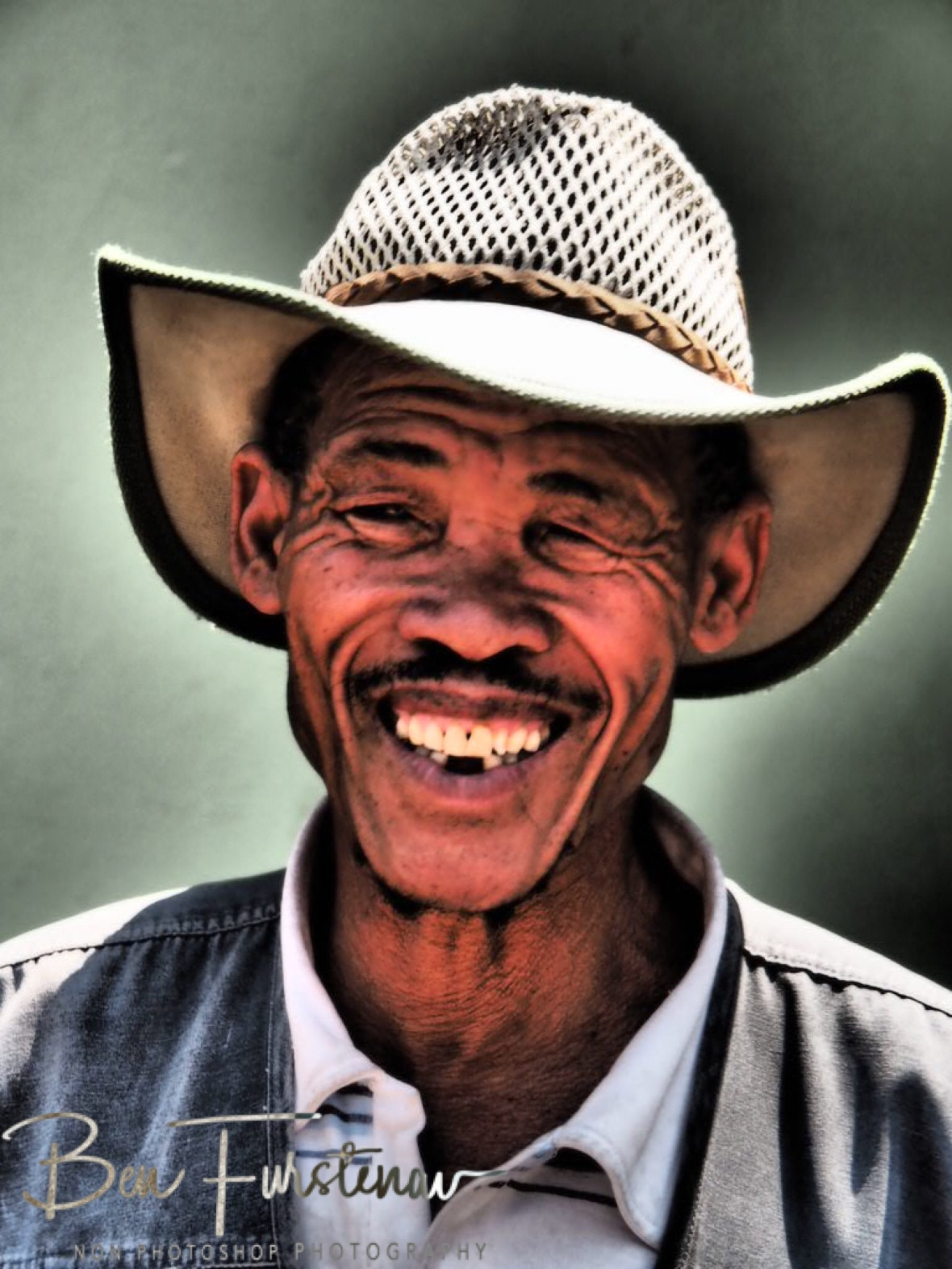 Happy bushman with oversized pants, Tsolido Hills, Kalahari desert, Botswana