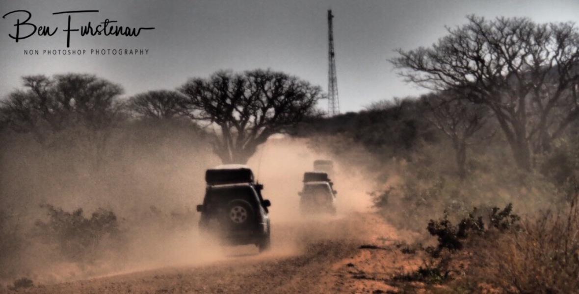 Dusty caravan, Kalahari desert, Botswana