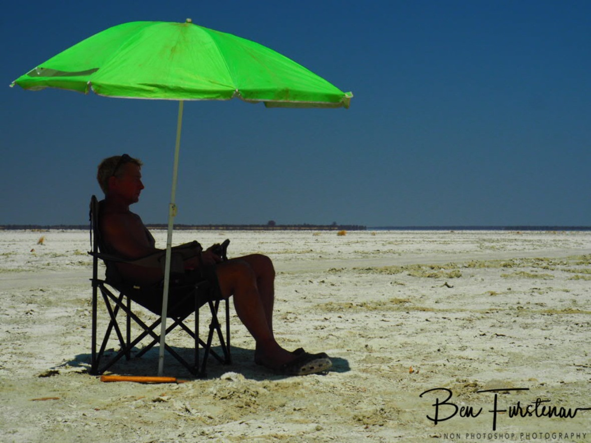 It's good to have an umbrella, Makgadikgadi Salt Pans, Botswana