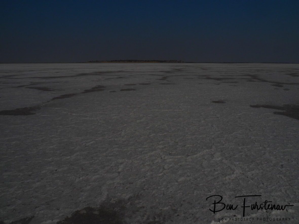 One last glimpse on Kubu Island over the horizon, Makgadikgadi Salt Pans, Botswana