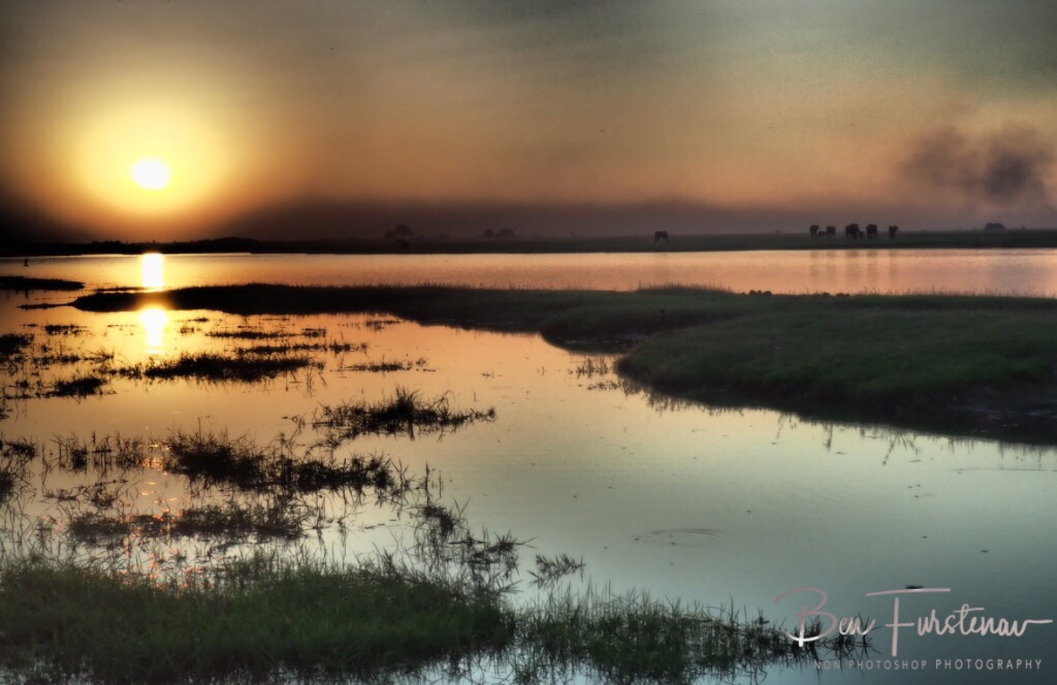 Sunset over calm waters off the Chobe River, Chobe National Park, Botswana