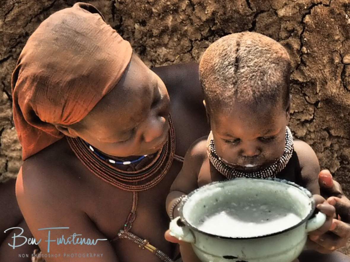 All goes with mom's help, Omusaona Himba Village, Kamanjab, Namibia