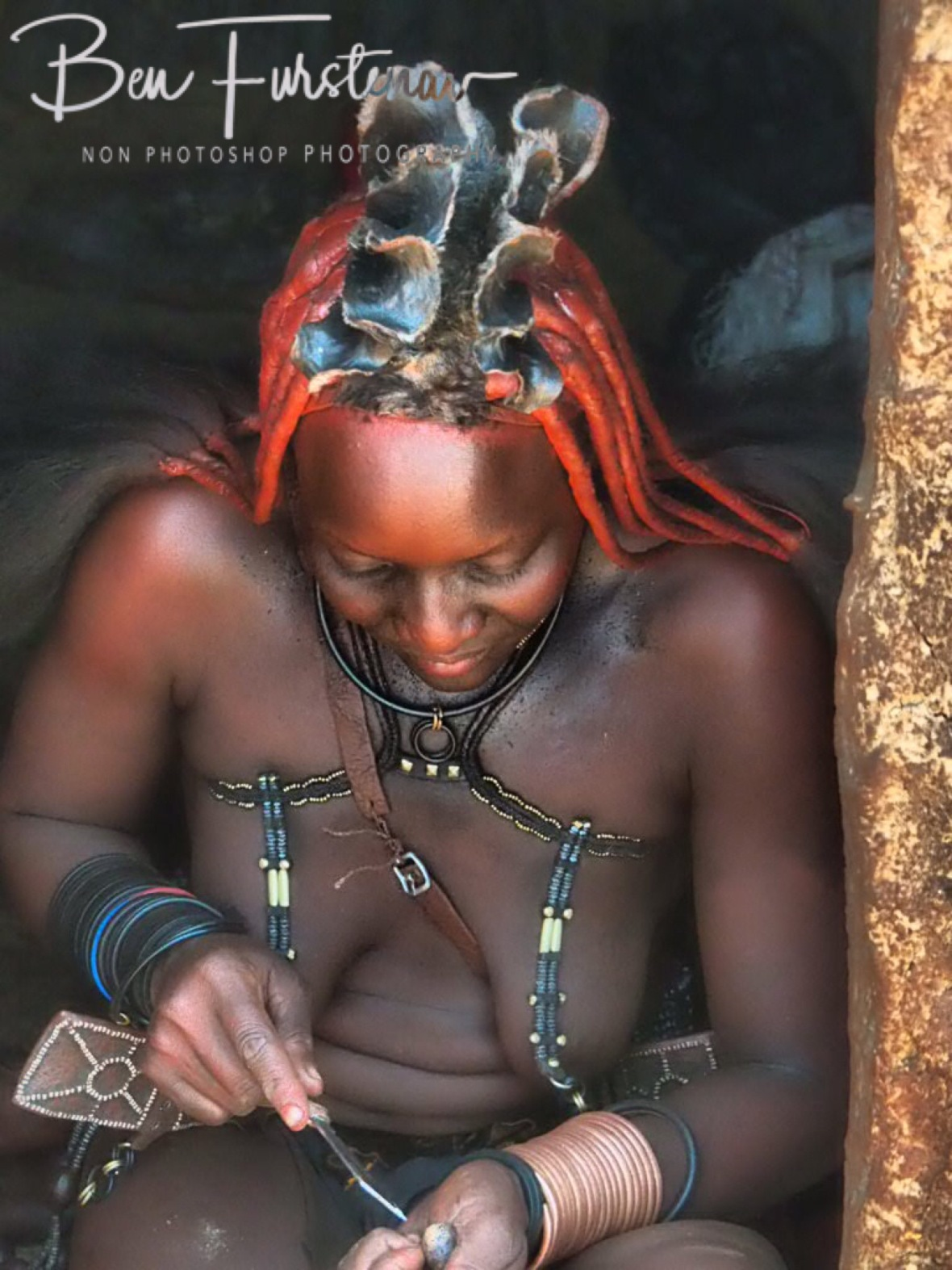 Making jewellery, Omusaona Himba Village, Kamanjab, Namibia