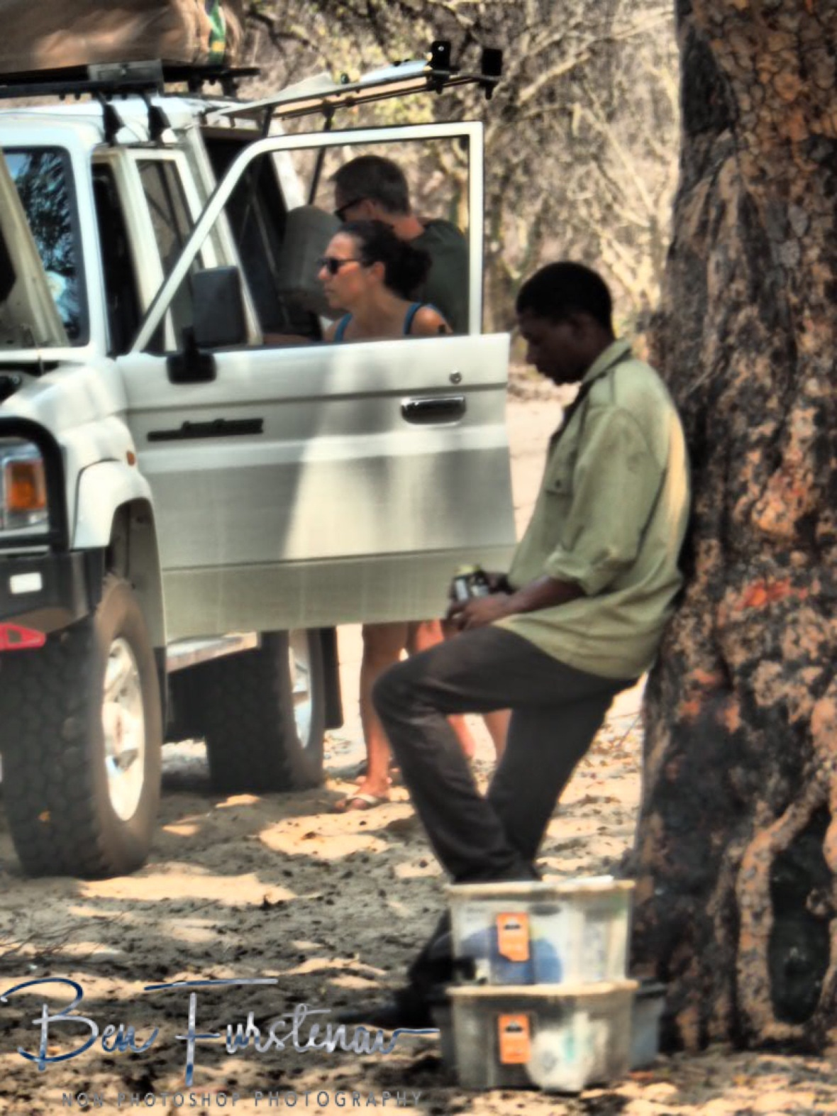 Chris deep in thoughts, enjoying a cold beer, Khaudum National Park, Namibia