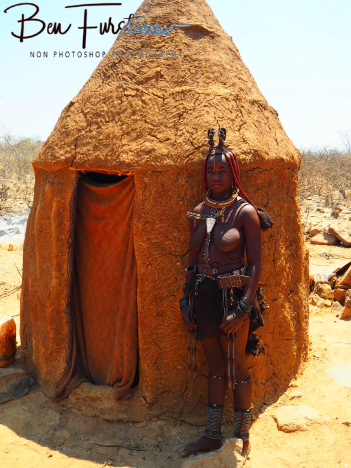 This woman has one child, Omusaona Himba Village, Kamanjab, Namibia