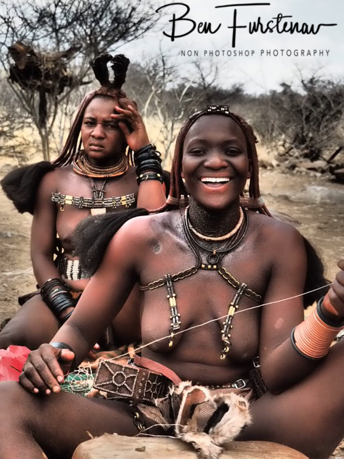 Having a laugh about a silly question. Nice to see! Omusaona Himba Village, Kamanjab, Namibia