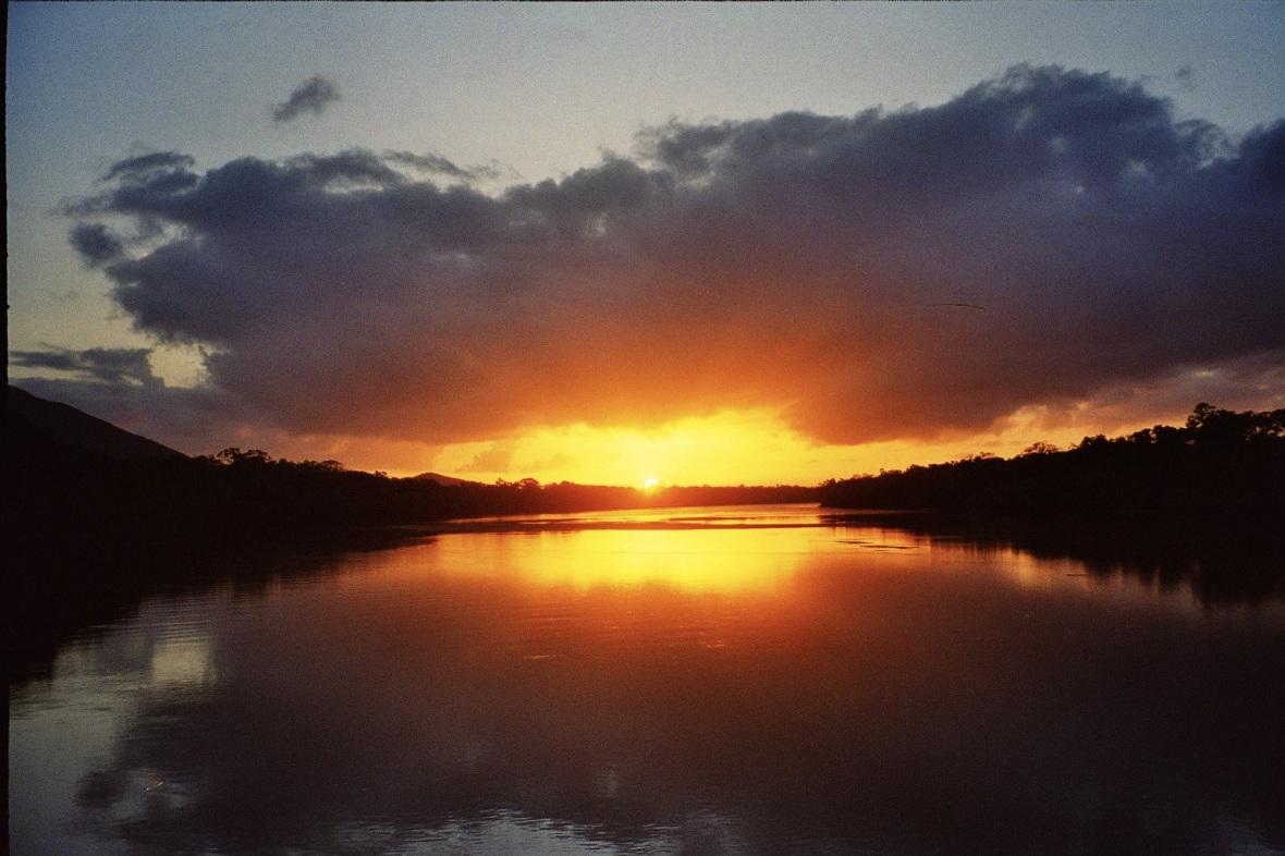 Calm sunrise over the Endeavour River in Cooktown, Queensland, Australia